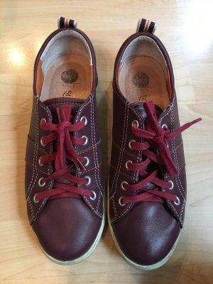 Bordeaux farbene Leder Sneakers