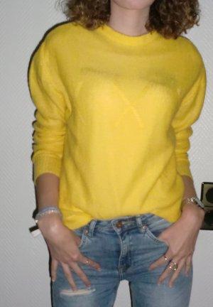 Pull tricoté jaune