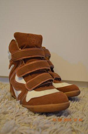 Sneaker con strappi marrone-bianco