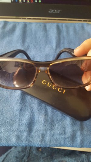 Gucci Glasses dark brown synthetic material