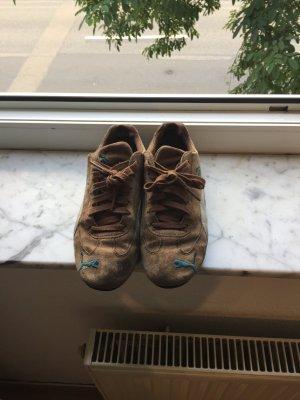 Braune PUMA sneakers