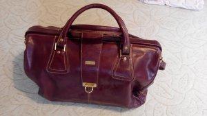 braune Vollrindleder Reisetasche mit 4 Rollen und Schulterriemen