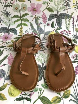 Braune Zehentrenner-Sandalen aus Leder