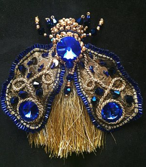 Brooch gold-colored-blue glas