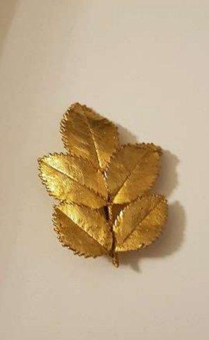 Broche goud