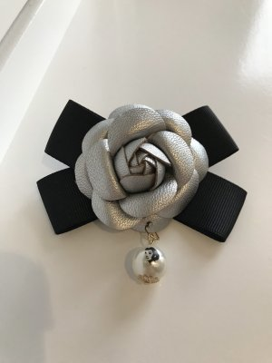 Brooch black-silver-colored
