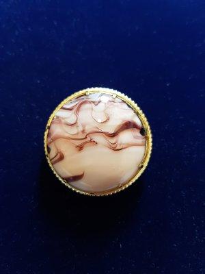 Broche color oro-rosa