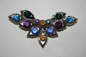 Broche color plata metal