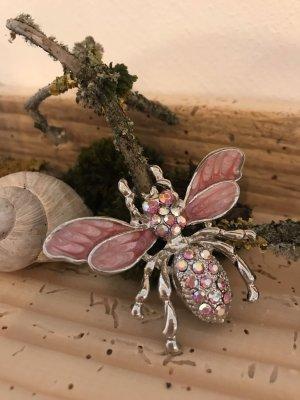 Broche color plata-rosa