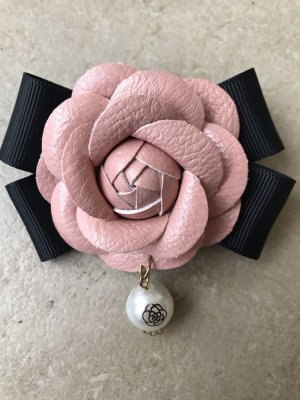 Broche noir-or rose