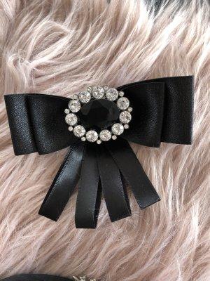 Spilla nero-argento Fibra sintetica