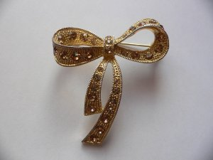 Broche color oro