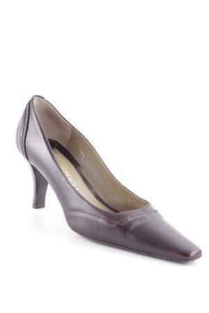 Bruno Cucinelli Loafers zwart bruin klassieke stijl