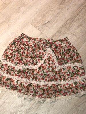 Falda con volantes blanco-rosa