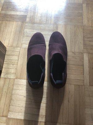 Burgunderfarbende Chelsea Boots