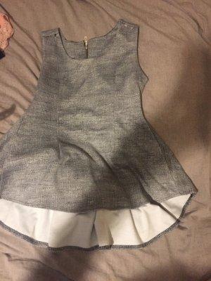 Blusa larga gris