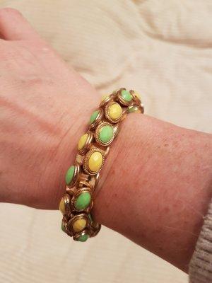 Cabochon Armband goldfärbig mit Steinchen in gelb/grün