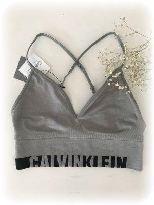 Calvin Klein Bustier, grau mit schwarzem Calvin Klein Schriftzug am Bund hinten und vorne, Gr.  S
