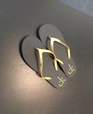 Calvin Klein Flip-Flop Sandals black-gold-colored