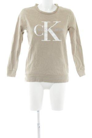 Calvin Klein Jeans Rundhalspullover beige Schriftzug gedruckt schlichter Stil