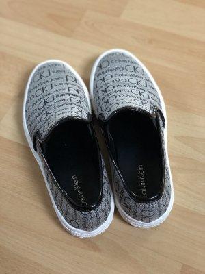 Calvin Klein Sneaker, Slipper, Halbschuhe, grau/Gold/schwarz