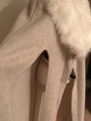 Poncho in maglia beige chiaro