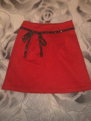 Falda acampanada rojo ladrillo