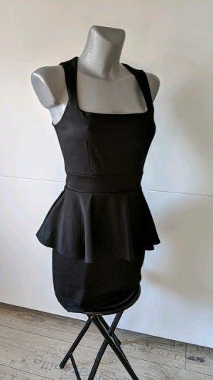 Casual Couture by Green envelope Kleid Gr. S 36 schwarz stretch Schößchenkleid Peplum