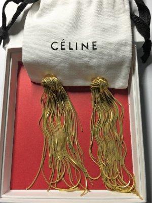 Céline Riesin Ohrclips ist mit einem Knoten
