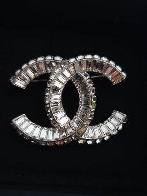 Chanel Broche color plata