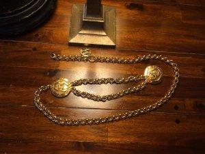 Chanel Accesorio color oro metal