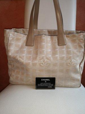 Chanel Comprador color oro-beige