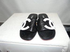 Chanel Zuecos negro Cuero