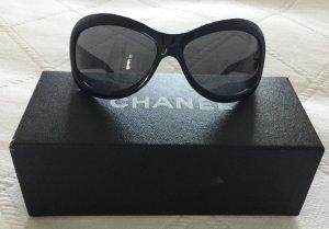 Chanel Occhiale da sole ovale nero-marrone scuro