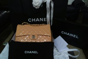 Chanel Bolsa naranja claro-rosa empolvado Cuero