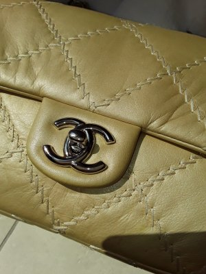 Chanel Ultimate Stitch Flap Bag in Goldbeige size Medium