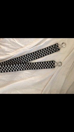 Cinturón blanco-negro