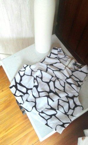 Chicabootie, schwarz weißes Crop Top mit durchgängigem Reißverschluss im Rückenbereich