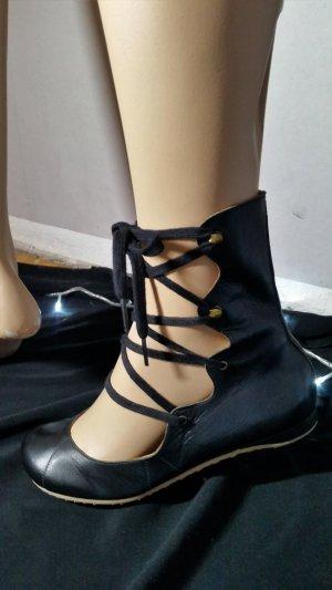 Sandalias romanas negro Cuero