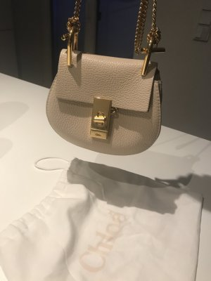 Chloé Drew in light beige