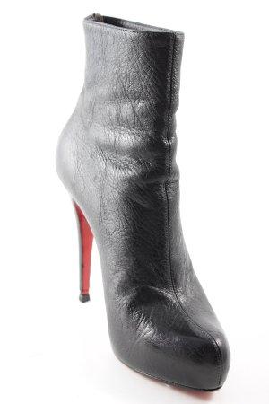 Christian Louboutin Reißverschluss-Stiefeletten schwarz-rot Party-Look