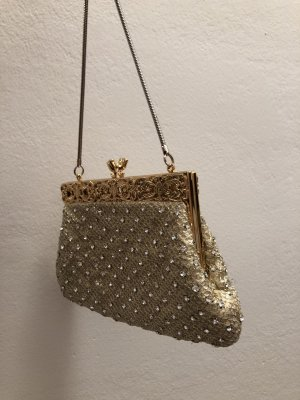 Bolso de mano color oro-color plata
