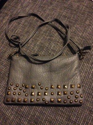 Clutch/Umhängetasche grau mit Bronze Nieten von Pieces
