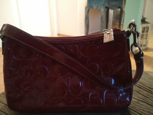 Coach Pochette carmine leather