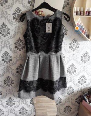 Peplum jurk zwart-grijs