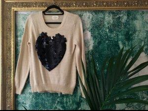 Cooler Pullover mit Pailletten