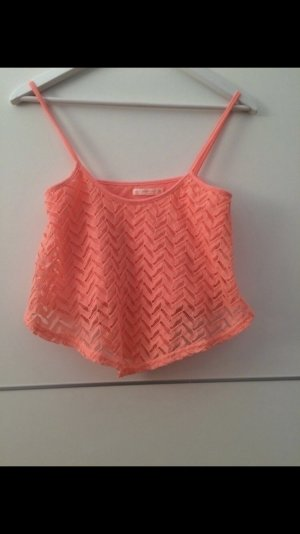 Cooles crop top in Koralle