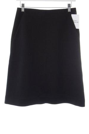 COS Glockenrock schwarz minimalistischer Stil