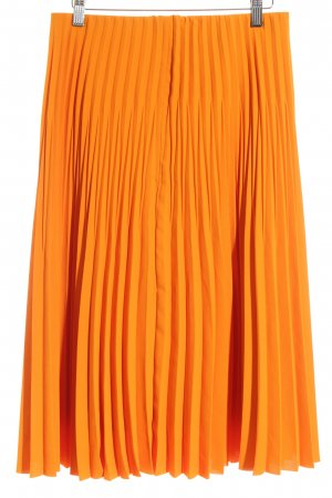 COS Pleated Skirt neon orange street-fashion look