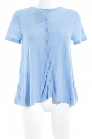 COS Camiseta azul celeste look casual